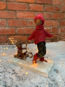 Boy Sledging Sculpture